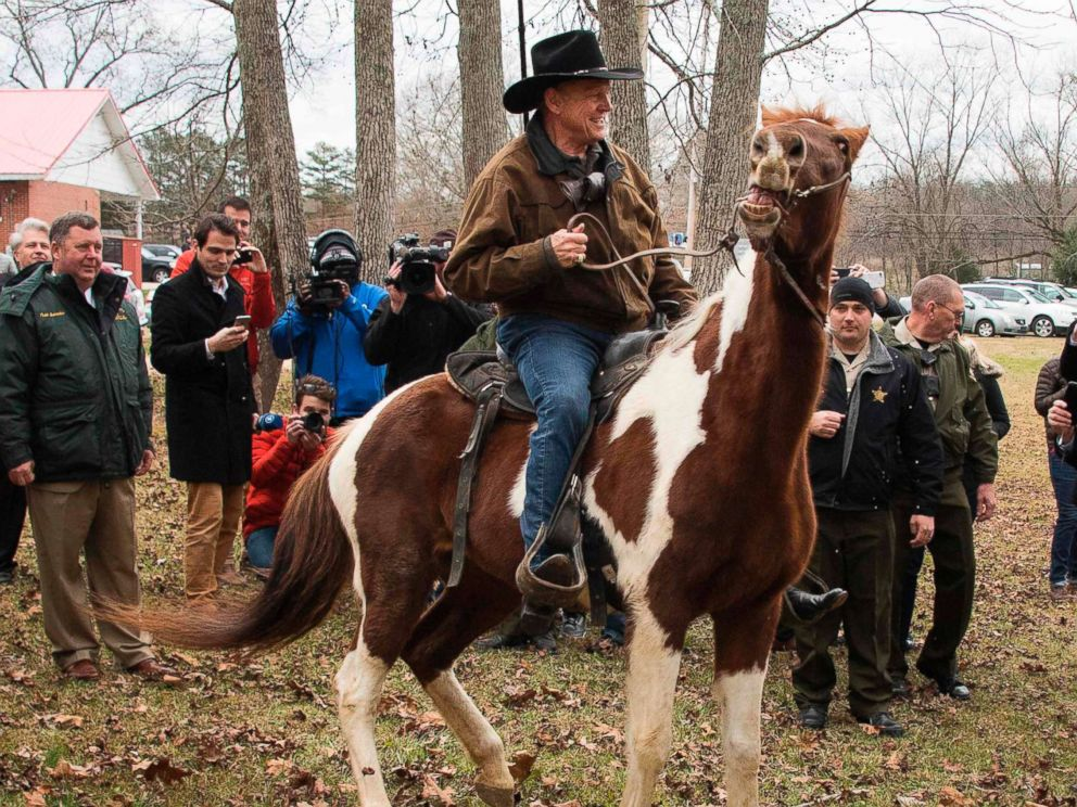 PHOTO: Republican senatorial candidate Roy Moore departs on his horse at the polling station after voting in Gallant, Ala., Dec. 12, 2017.