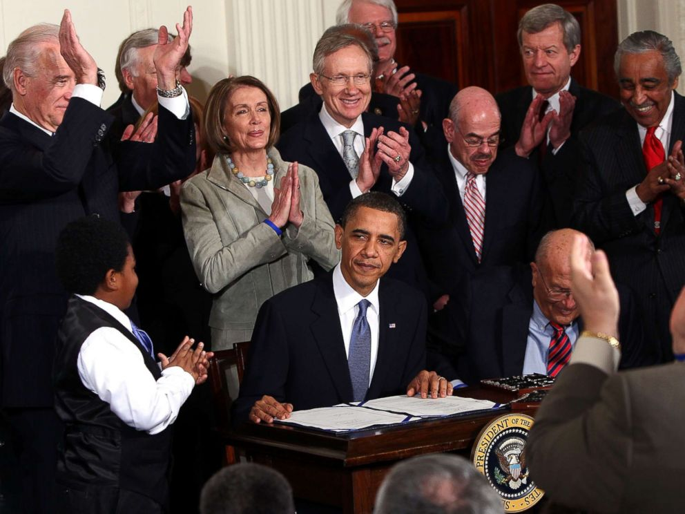 PHOTO: President Barack Obama is applauded after signing the Affordable Health Care for America Act during a ceremony with fellow Democrats in the East Room of the White House, March 23, 2010 in Washington, D.C.