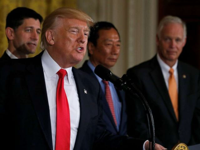 PHOTO: President Donald Trump (2nd L), flanked by House Speaker Paul Ryan (L), Foxconn Chairman Terry Gou (C) and Senator Ron Johnson (R), delivers remarks at a White House event in Washington, D.C., July 26, 2017.