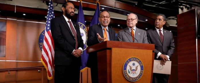 PHOTO: Rep. Luis Gutierrez (D-IL), with by Rep. Al Green (D-TX), Rep. Steve Cohen (D-TN) and Rep. Adriano Espaillat (D-NY), speaks at a press conference announcing articles of impeachment filed against President Donald Trump in Washington, Nov. 15, 2017.