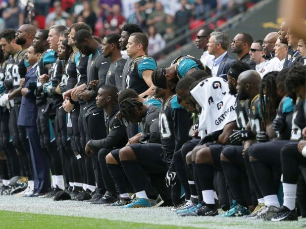 PHOTO: Jacksonville Jaguars players lock arms and kneel down during the playing of the U.S. national anthem before an NFL football game against the Baltimore Ravens at Wembley Stadium in London, Sept. 24, 2017.
