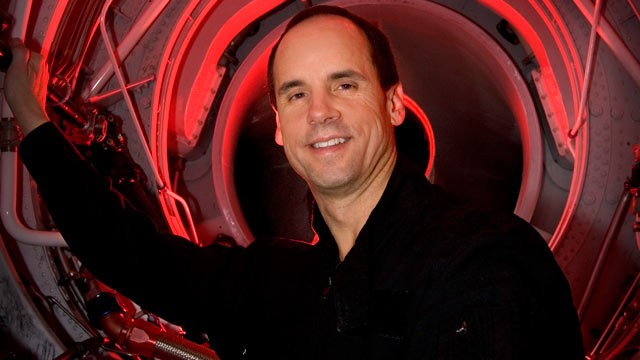 PHOTO: In this Dec. 12, 2005 file photo, Steve Appleton, CEO and chairman of Micron Technology Inc., looks out through the engine compartment of his stunt jet airplane inside the hanger where he keeps several different types of aircraft  in Boise, Idaho.