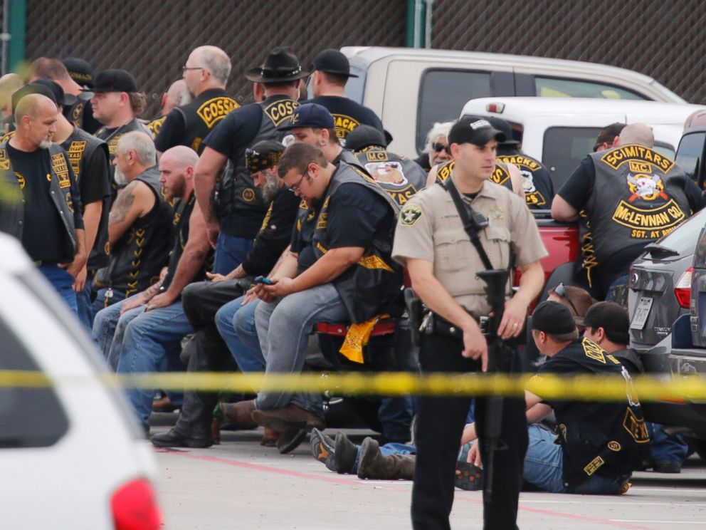 PHOTO: A McLennan County deputy stands guard near a group of bikers in the parking lot of a Twin Peaks restaurant Sunday, May 17, 2015, in Waco, Texas.