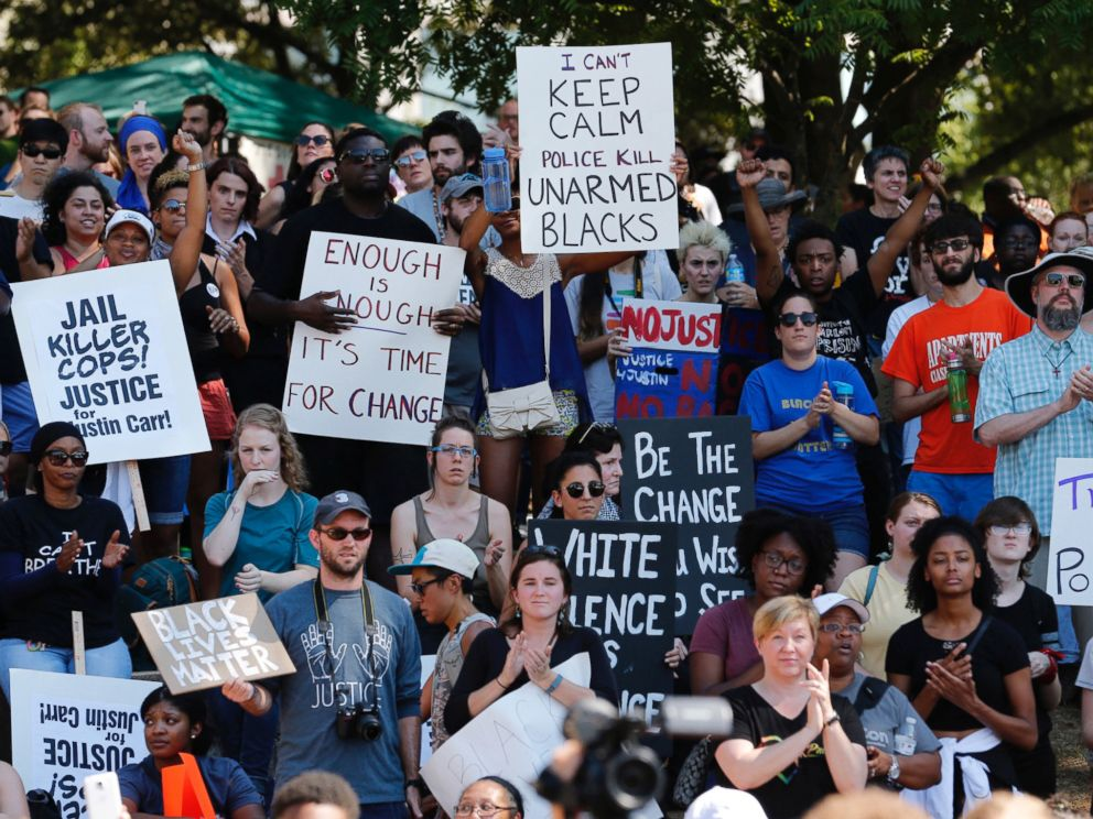 PHOTO: People cheer at a rally at Marshall Park to protest the police shooting of Keith Scott, in Charlotte, North Carolina, Sept. 24, 2016.