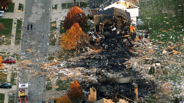 PHOTO: This aerial photo shows the two homes that were leveled and the numerous neighboring homes that were damaged from a massive explosion, Nov. 11, 2012.