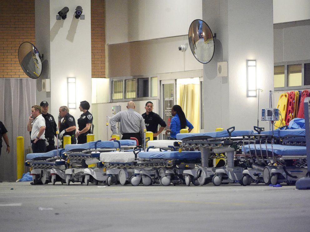 PHOTO: Emergency personnel wait with stretchers at the emergency entrance to Orlando Regional Medical Center hospital for the arrival of patients from the scene of a fatal shooting at Pulse Orlando nightclub in Orlando, Fla., Sunday, June 12, 2016.