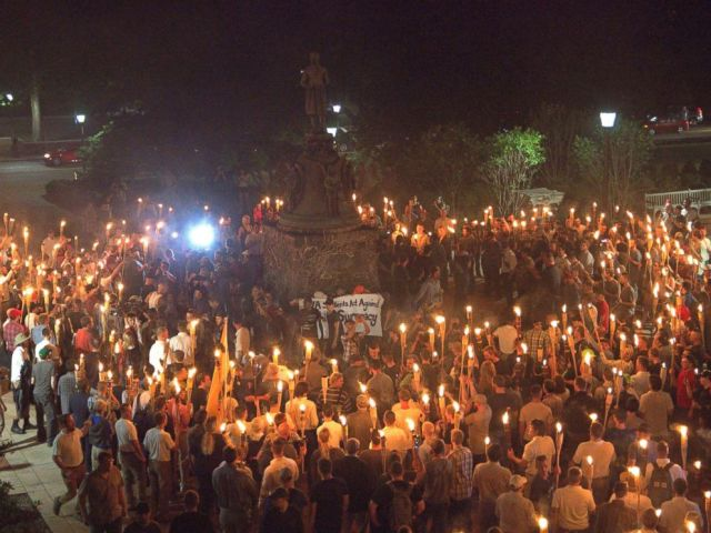 PHOTO: White nationalists carry torches around a statue of Thomas Jefferson on the grounds of the University of Virginia, on the eve of a planned Unite The Right rally in Charlottesville, Va., Aug. 11, 2017.
