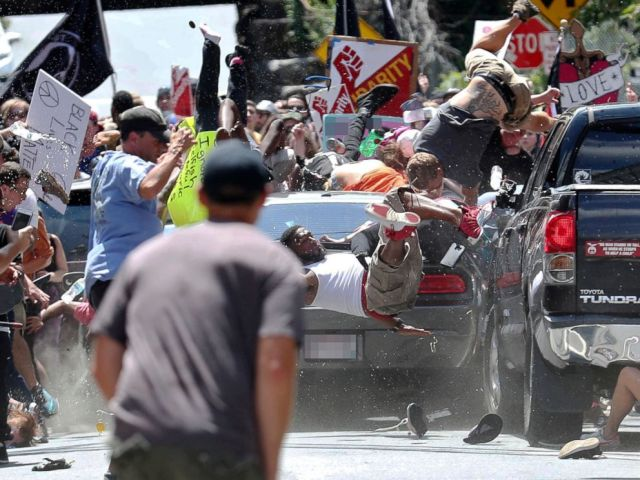 PHOTO: People fly into the air as a vehicle drives into a group of protesters demonstrating against a white nationalist rally in Charlottesville, Va., Aug. 12, 2017.