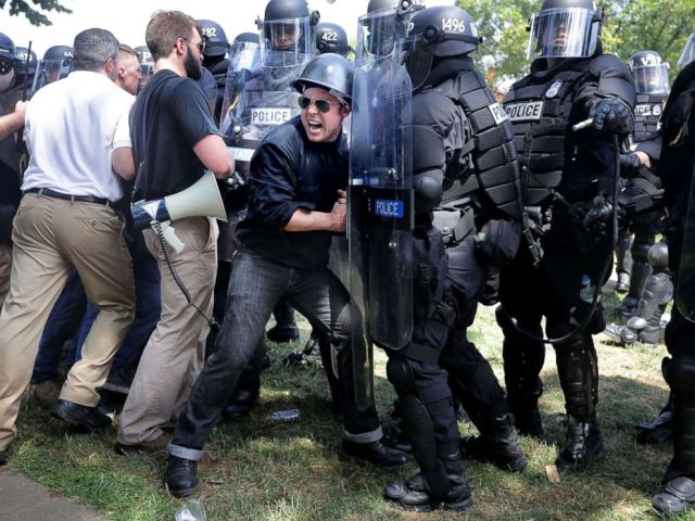 PHOTO: White nationalists, neo-Nazis and members of the alt-right clash with police as they are forced out of Lee Park after the Unite the Right rally was declared an unlawful gathering, Aug. 12, 2017 in Charlottesville, Va.