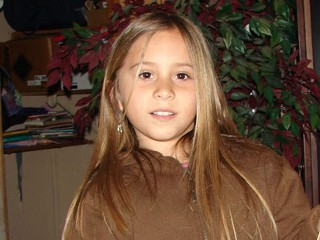 Eight-year-old Sandra Cantu, who disappeared March 27, was found murdered in a black suitcase April 7 after a long, painful search.  Her playmate's mother, Melissa Huckaby, is being held in connection with her kidnapping and murder (Courtesy: ABC News)