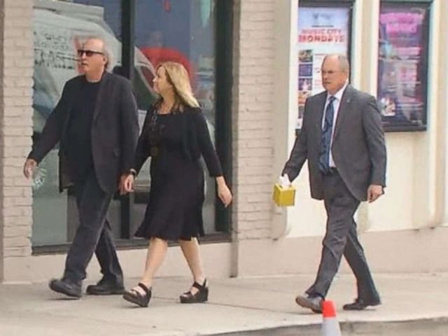 PHOTO: Nashville mayor Megan Barry walks to her sons visitation in July 2017 with her husband Bruce (left) and Sgt. Robert Forrest, the retired police officer whom admitted, along with the mayor, that they had an affair.