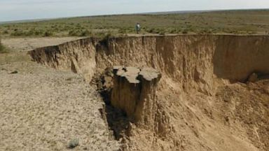 A large sinkhole has opened in a pasture in Sharon Springs, Kansas.