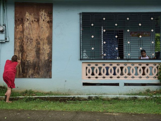PHOTO: A woman boards up a window in preparation for Hurricane Irma, in Ceiba, Puerto Rico, Sept. 6, 2017.