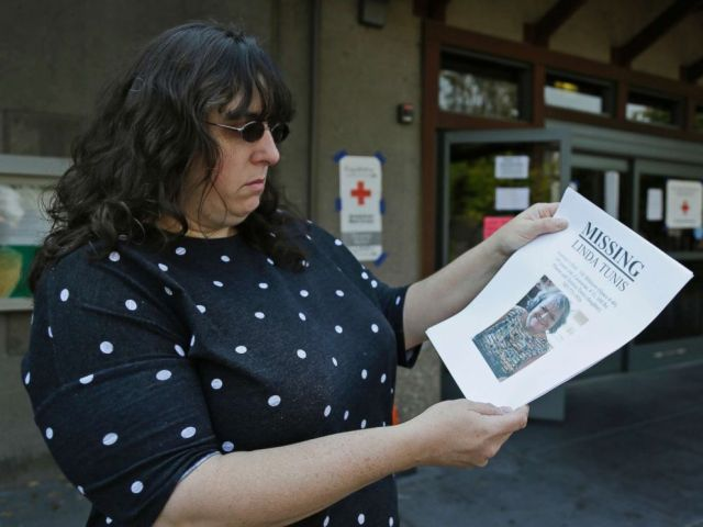 PHOTO: Jessica Tunis stands outside a Red Cross evacuation center and holds a flyer about her missing mother, Oct. 11, 2017, in Santa Rosa, Calif.