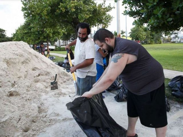PHOTO: Miami resident Jan-Michael Medina collecting sandbags with his brother-in-law Charlie Hernandez.