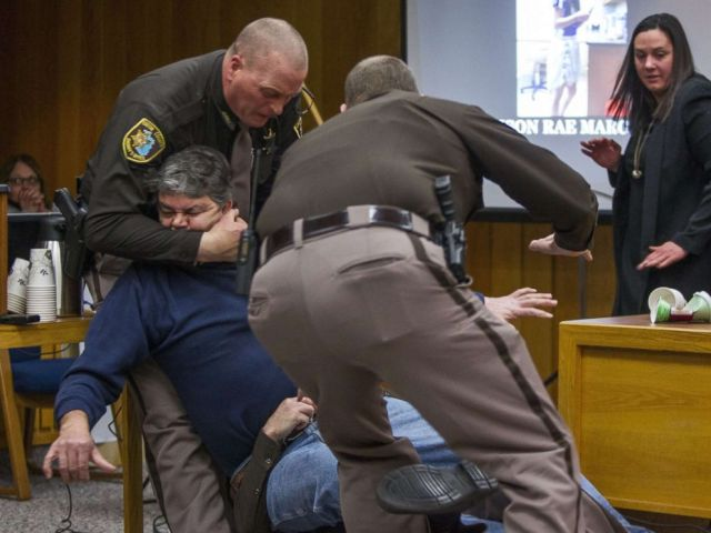 PHOTO: Eaton County Sheriffs deputies restrain Randall Margraves, father of three victims of Larry Nassar, Feb. 2, 2018, in Eaton County Circuit Court in Charlotte, Mich.