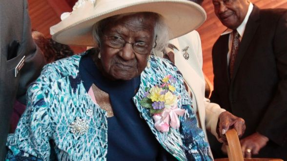 PHOTO: Jeralean Talley is escorted down the aisle after the church service honoring her 115th birthday at the New Jerusalem Missionary Baptist Church in Inkster, Michigan May 25, 2014.