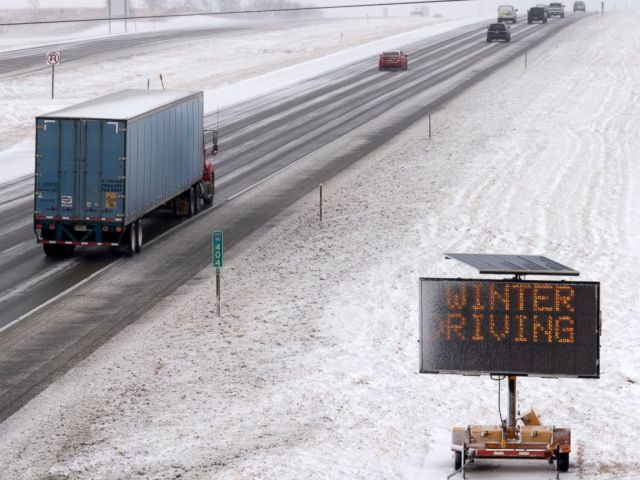 PHOTO: A Nebraska Department of Transportation sign warns drivers of winter weather on Interstate 80 East on the edge north side of Lincoln, Neb., Jan. 22, 2018.