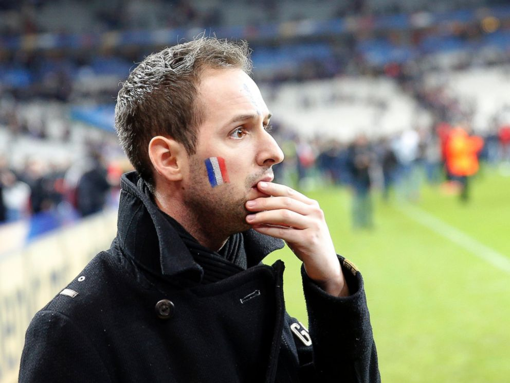 PHOTO: A French supporter reacts after invading the pitch of the Stade de France stadium at the end of a soccer match between France and Germany in Saint Denis, outside Paris, Nov. 13, 2015.