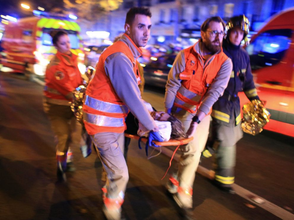 PHOTO: A woman is evacuated from the Bataclan theater after a shooting in Paris, Nov. 13, 2015.
