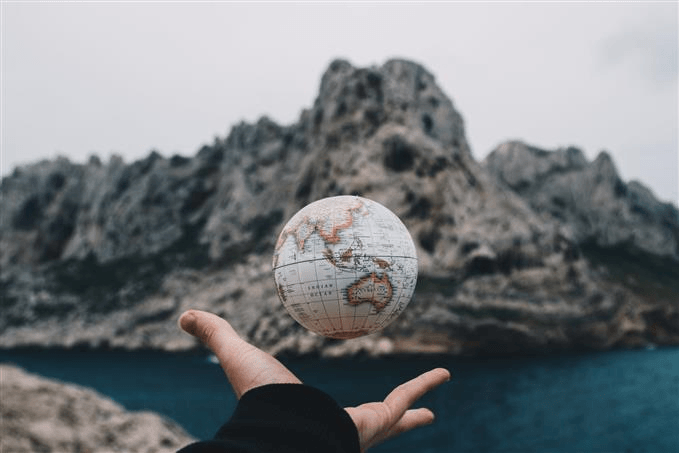 Small globe against a cliffside backdrop