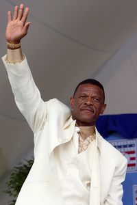 Rickey Henderson waves to crowd during Hall of Fame ceremonies yesterday in Cooperstown, New York which saw him inducted into the Baseball Hall of Fame.