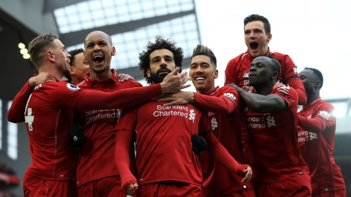Liverpool players swamped Mohamed Salah after his wonder strike against Chelsea.