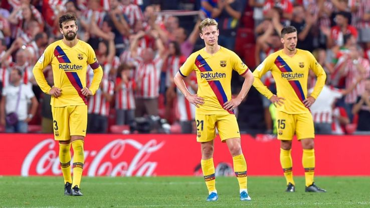 Barcelona players react during their La Liga loss to Athletic Bilbao.