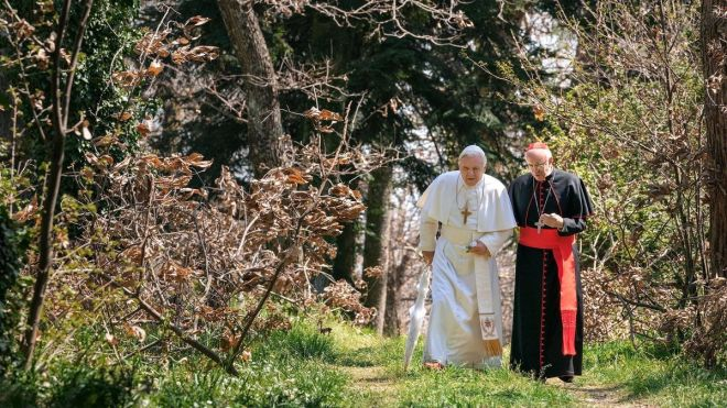 The Two Popes walking in a garden