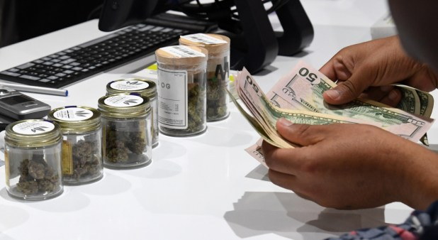 A customer pays for cannabis products at Essence Vegas Cannabis Dispensary after the start of recreational marijuana sales began on July 1, 2017 in Las Vegas, Nevada.