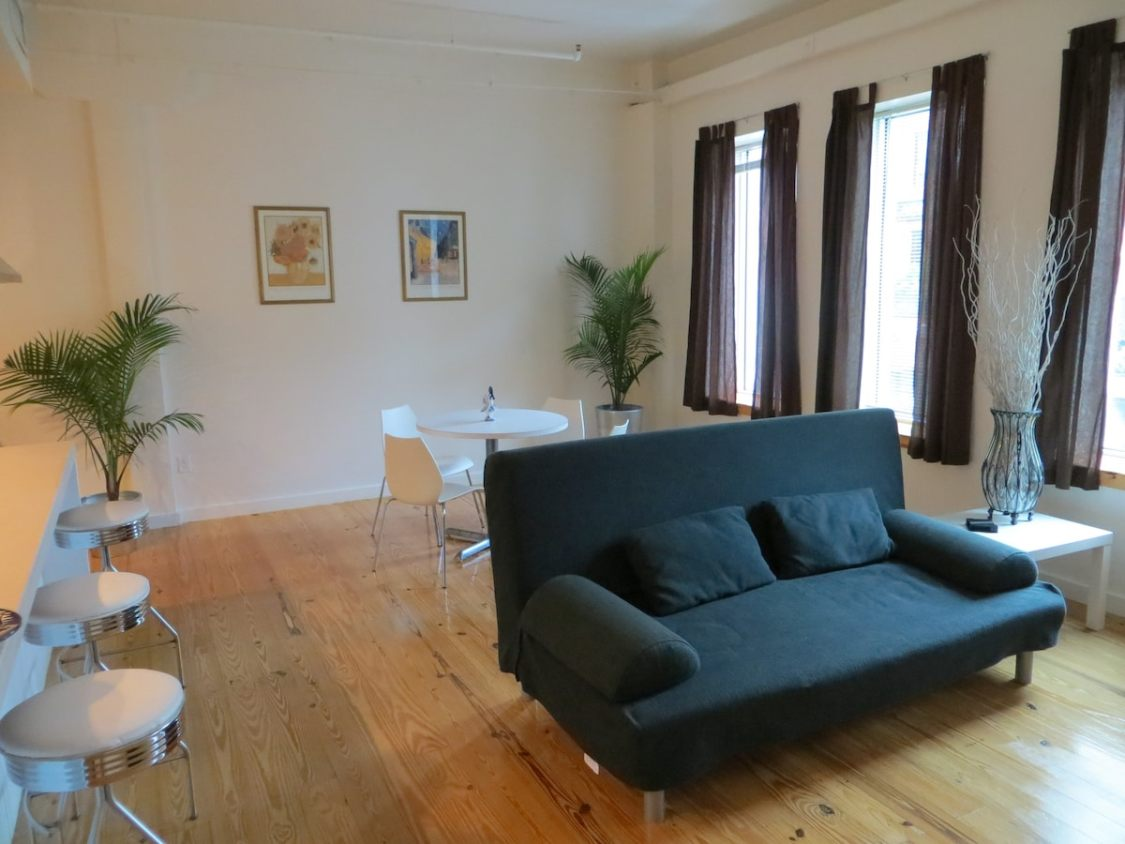 green couch in downtown Tampa loft Airbnb