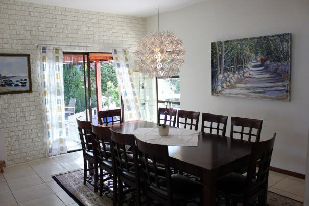 Dining room with direct access to the patio and braai/barbeque area!