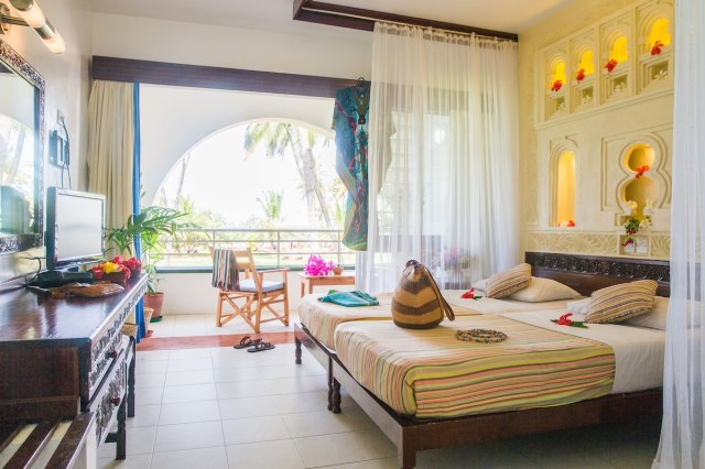 Spacious rooms overlooking private garden with balcony, A/C, TV and private bathroom.