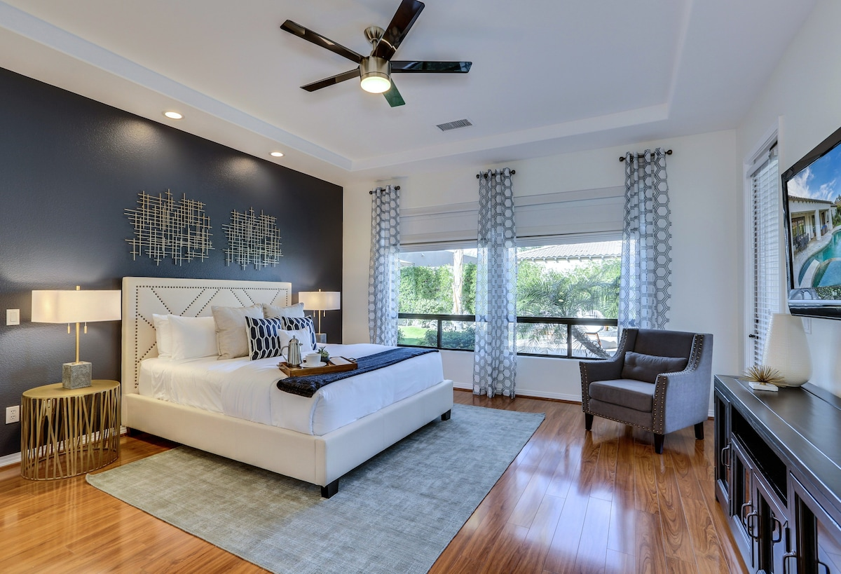Large Master Bedroom Suite with California King Size Bed, Plush Mattress, Big Screen TV and Office Desk