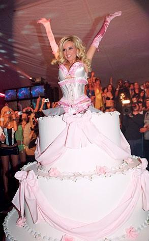 Well, it looks like a cake. Maybe its just her skirts.