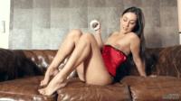 Posing On A Sofa