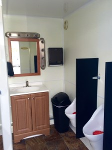 Medium Restroom Trailer Rentals DE - male inside 2