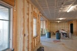 """Flashing of +/- 1"""" of spray foam at exterior walls. Cellulose insulation at first floor deck."""