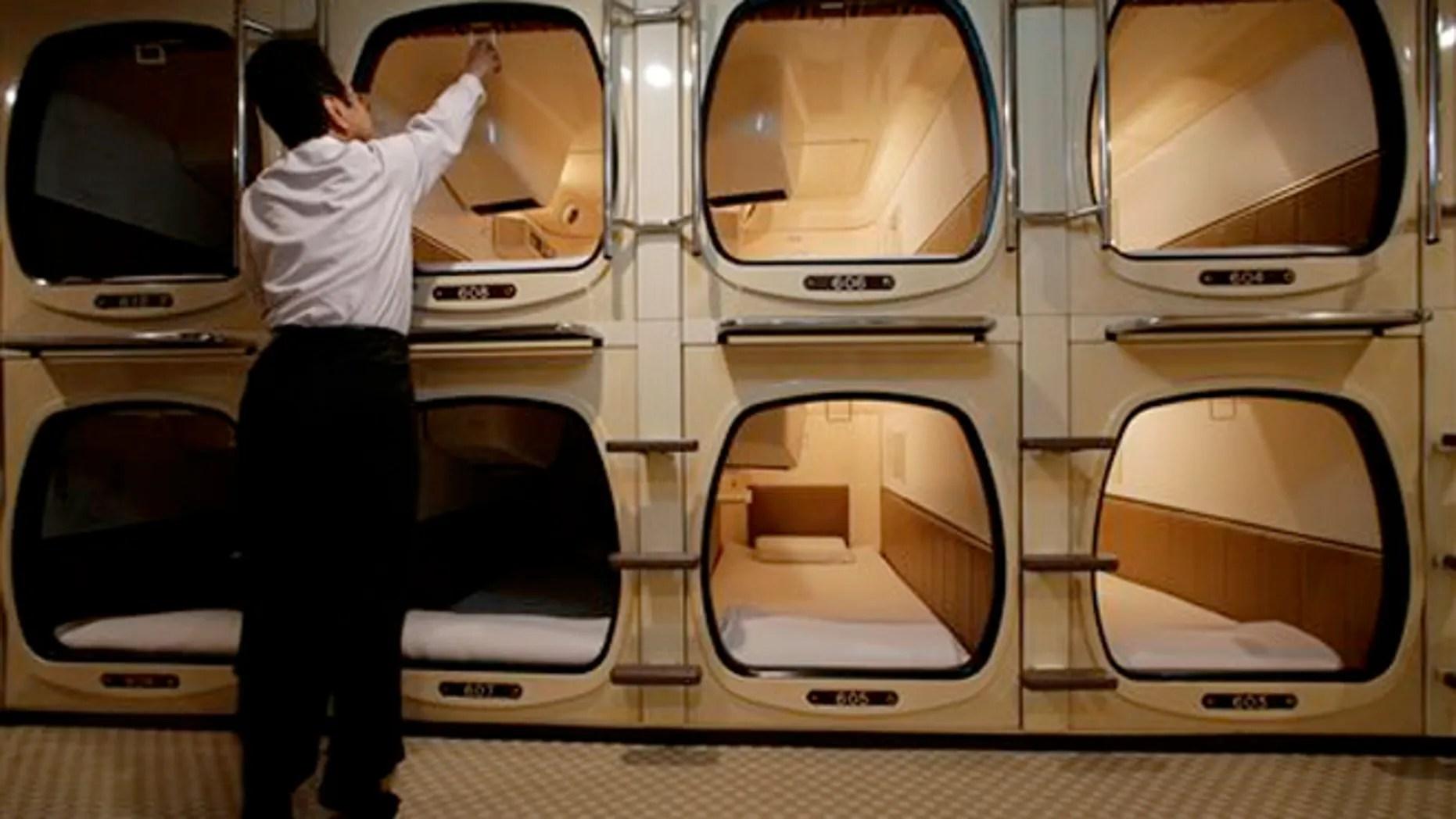Squeezing Capsule Hotel Room In Japan Fox