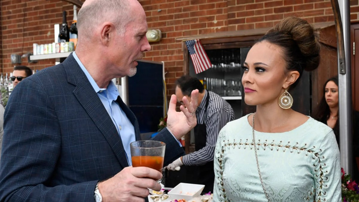 """Michael Darby, left, and wife Ashley Boalch Darby on an episode of """"The Real Housewives of Potomac."""""""