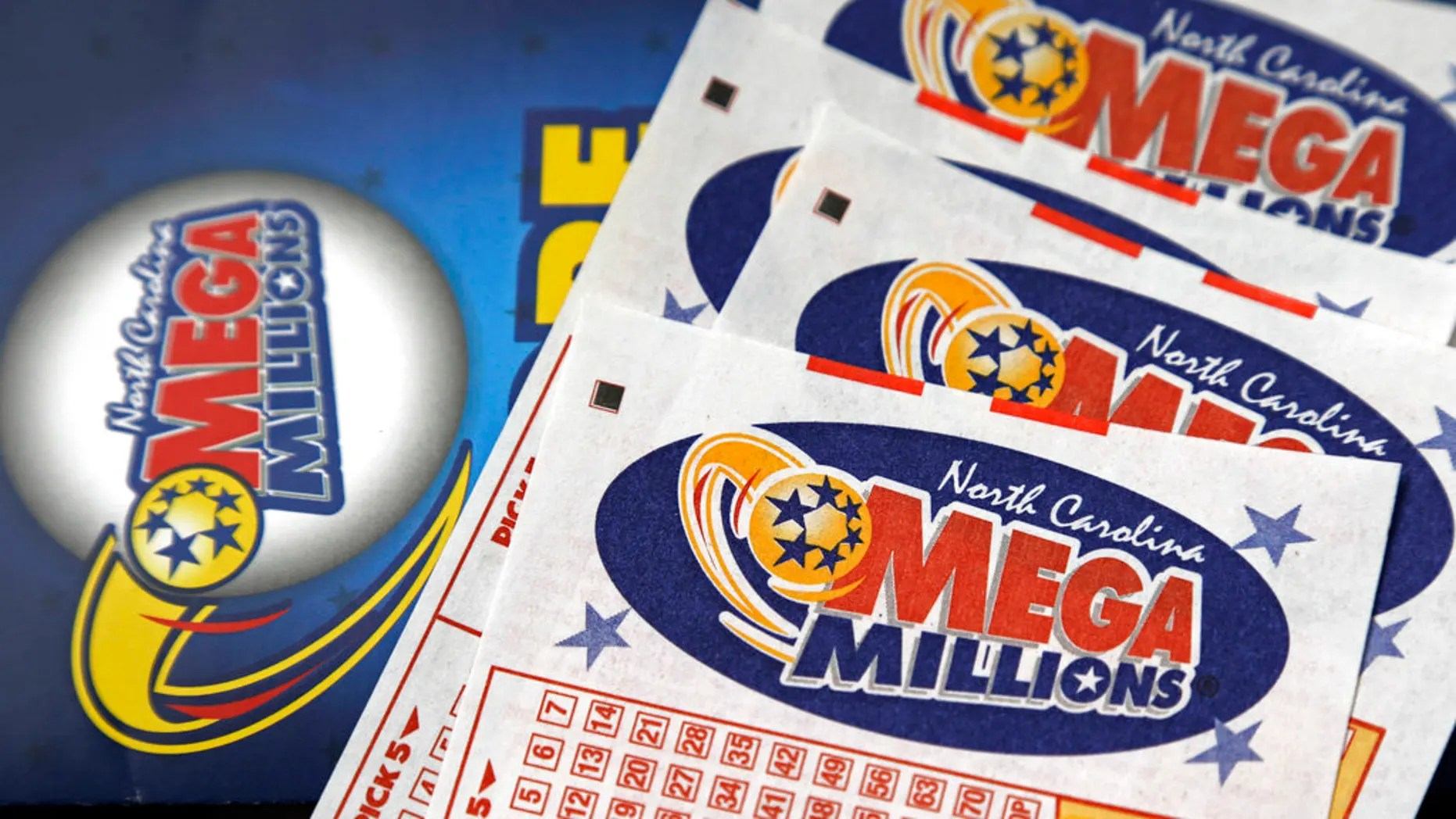 FILE: This photo shows Mega Millions lottery tickets on a counter at a Pilot travel center near Burlington, N.C.