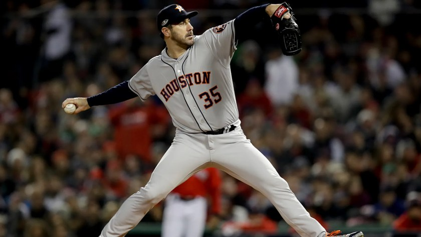 Houston Astros starting pitcher Justin Verlander throws against the Boston Red Sox during the first inning in Game 1 of a baseball American League Championship Series on Saturday, Oct. 13, 2018, in Boston.