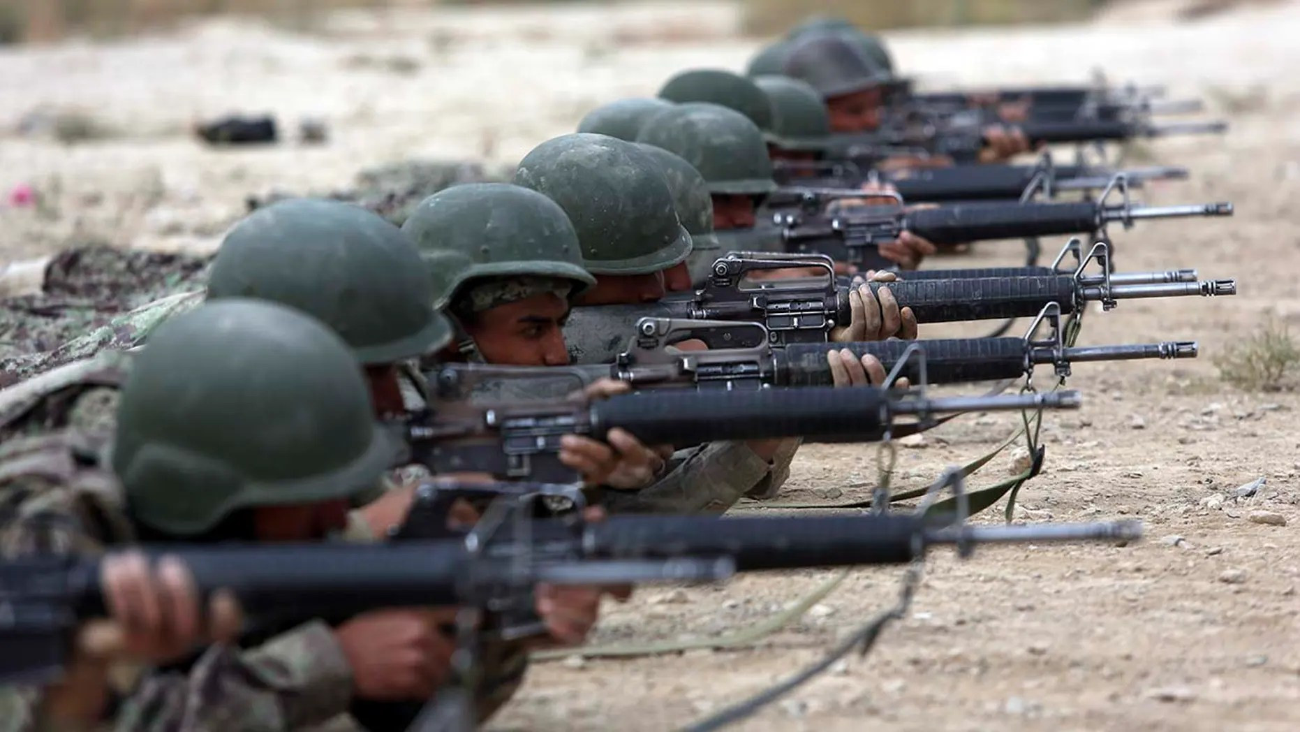 FILE - In this Oct. 31, 2018, file photo, Afghan National Army soldiers participate in a live fire training exercise, at the Afghan Military Academy, in Kabul, Afghanistan. (Associated Press)