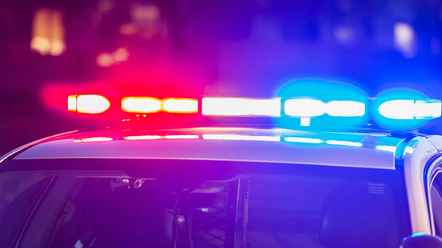 A police officer with the city of Davis, Calif., was in serious condition late Thursday after she was shot while responding to a triple-car accident, authorities say. The suspect is being sought.