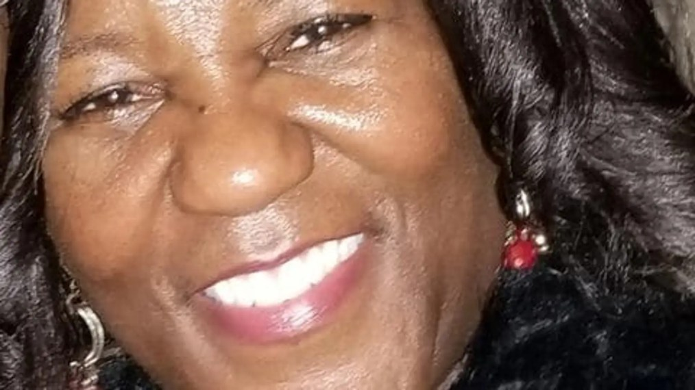 Jacquelyn Smith, 52, was fatally stabbed early Sunday after giving money to a woman who appeared to be a panhandler.