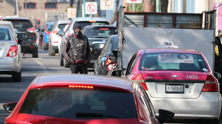 A biker takes a breather waiting in line for fuel in Mexico City