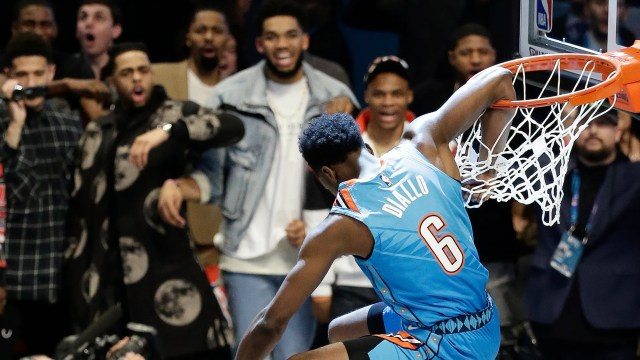 Oklahoma City Thunder Hamidou Diallo leaps over former NBA player Shaquille O'Neal during the NBA All-Star Slam Dunk contest, Saturday, Feb. 16, 2019, in Charlotte, N.C. Diallo won the contest. (AP Photo/Gerry Broome)