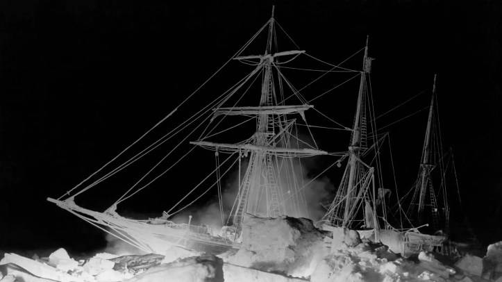File photo - Shackleton's ship, the Endurance, as it lay locked in the Weddell Sea, where it finally sank, Antarctica, Aug. 27, 1915. The remarkable lighting was furnished by an oil fire at the bow and a great deal of flash (gun) powder. (Photo by Underwood Archives/Getty Images)