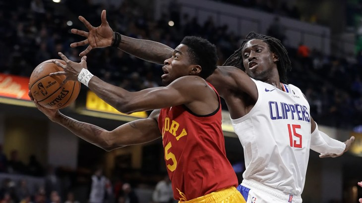 Indiana Pacers' Edmond Sumner shoots next to Los Angeles Clippers' Johnathan Motley during the second half of an NBA basketball game Thursday, Feb. 7, 2019, in Indianapolis. Indiana won 116-92.