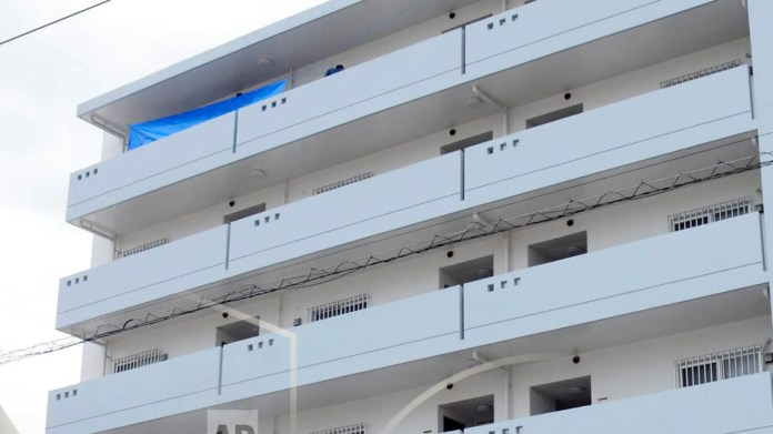 This photo shows an apartment where a U.S. serviceman and a Japanese woman were found dead in Okinawa, southwestern Japan, on Saturday. (Kyodo News via AP)